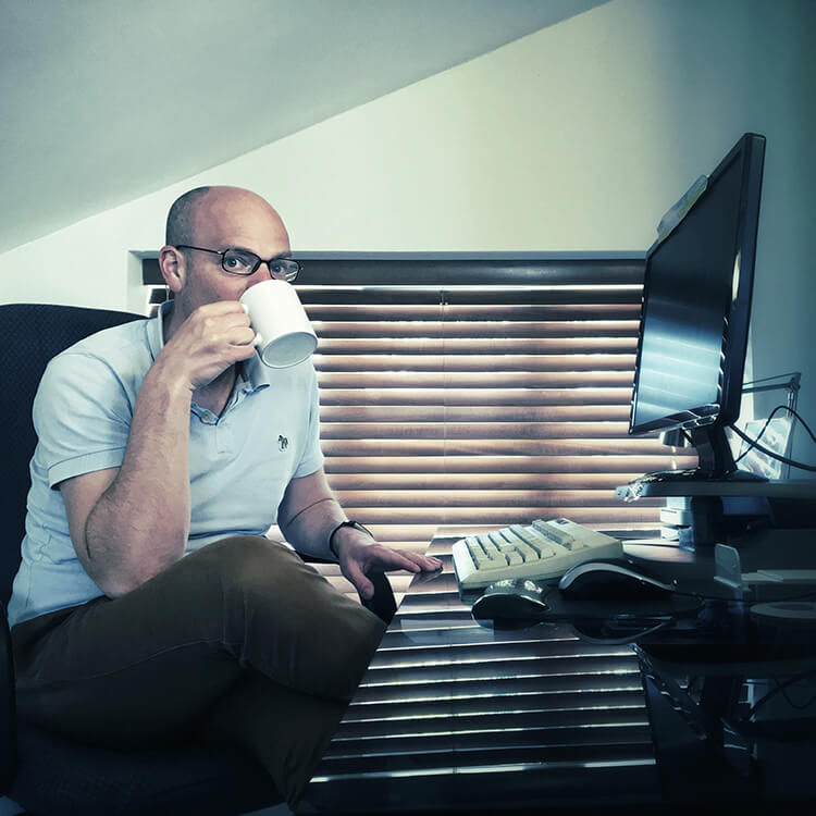 Copywriter Tom Albrighton at his desk